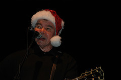 John Prine dons a Santa Cap - Photo by Capn Madd Matt